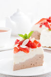 Piece of cake with whipped cream, strawberries and tea, vertical Stock Image