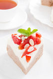 Piece of cake with whipped cream and strawberries, top view Stock Photo