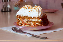 Piece of cake with white cream and saucer Royalty Free Stock Photos