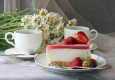 A piece of  cake, white cup of tea Royalty Free Stock Photo