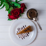 A piece of cake, white cup of tea and strawberries. Selective focus. Piece of cake with flowers on a plate and tea. Selective focus Royalty Free Stock Photography