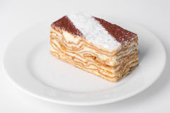 Piece of cake. On the white plate Stock Images