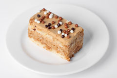Piece of cake. On the white plate Royalty Free Stock Photo