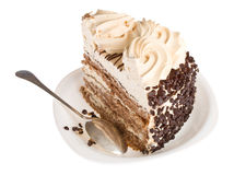Piece of cake on white plate with spoon Stock Image