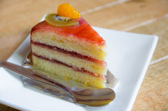 Piece of cake on white plate Stock Photos