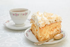 Piece of cake with white whipped cream and scattered almonds on Stock Photo