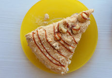 Piece of cake on the yellow plate. View from above Royalty Free Stock Images