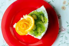 Piece of cake with yogurt and fruit Stock Images