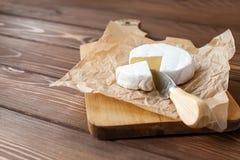 Piece of Camembert with knife Stock Photos