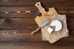 Piece of Camembert with knife Royalty Free Stock Photography