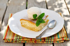 A piece of Caramel Apple Sponge Bake (Pudding) with a Banana Ice Stock Images