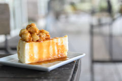 A piece of caramel cake with macadamia topping Stock Photography