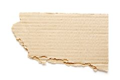 Piece of cardboard. Piece of brown corrugated cardboard on white stock photos