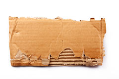 Piece of cardboard. Ripped piece of cardboard on white stock photos
