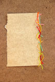 Piece of cardboard bright colorful wool thread, piece of paper e. Lement  laid out on cardboard with a place for accommodation on  background for scrapbook Stock Photo