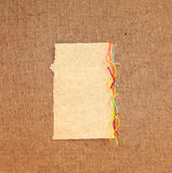 Piece of cardboard bright colorful wool thread, piece of paper e. Lement  laid out on cardboard with a place for accommodation on  background for scrapbook Stock Photography
