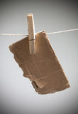 A piece of cardboard on cord Stock Photography