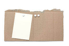 Piece of cardboard with pins and note Stock Photo