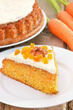 Piece of carrot cake with icing decorated dried apricots and wal Stock Images