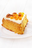 Piece of carrot cake with icing Stock Image