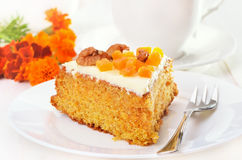 Piece of carrot cake with icing Stock Photography