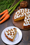 Piece of carrot cake. With icing decorated walnut on white plate Stock Photography