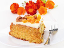 Piece of carrot cake with icing on white plate Royalty Free Stock Photos