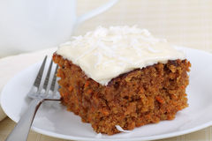 Piece of Carrot Cake. Sprinkled with coconut on a plate stock photography