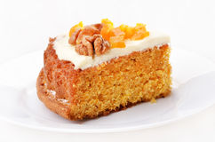 Piece of carrot cake on white plate Stock Photo