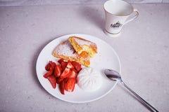 Piece of carrot pie plate dessert fresh strawberry ice cream Royalty Free Stock Image