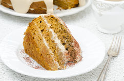 Piece of carrots and pumpkin cake with coffee cream Royalty Free Stock Image