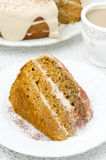 Piece of carrots and pumpkin cake with coffee cream on a plate Royalty Free Stock Photos