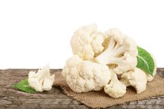 Piece of cauliflower on wooden table with white background.  Royalty Free Stock Photography