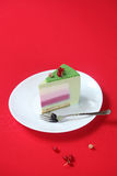 Piece of Celebration (Christmas) Matcha and Currants Mousse Cake Royalty Free Stock Image