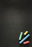 Piece of chalk on wood Royalty Free Stock Photo
