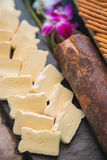 Piece of cheese on buffet line Royalty Free Stock Image