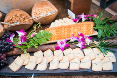 Piece of cheese on buffet line Royalty Free Stock Photos