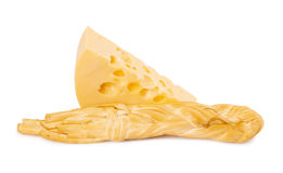 Piece of cheese and cheese braided Royalty Free Stock Photo