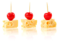 Piece cheese with cocktail cherry Royalty Free Stock Photography