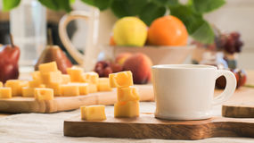 A piece of cheese with coffee Stock Photos
