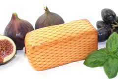 Piece of cheese with figs Stock Images
