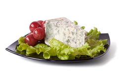 Piece of cheese and grapes Royalty Free Stock Photos