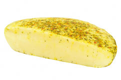 Piece of cheese with herbs Stock Images