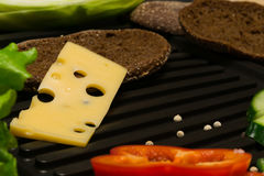 A piece of cheese with holes Royalty Free Stock Images