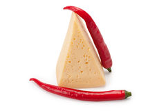 Piece of cheese and hot peppers Royalty Free Stock Photos
