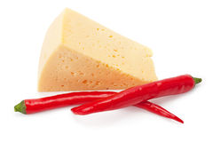 Piece of cheese and hot peppers Stock Photo