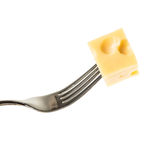 A piece of cheese on an iron fork Royalty Free Stock Photos