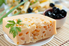 Piece of of cheese and olives. Closeup Stock Image