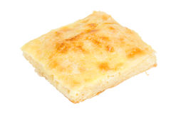 Piece of cheese pie. Freshly baked piece of cheese pie isolated on a white background stock photo