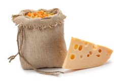 Piece of cheese sack with pasta Stock Images